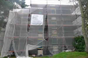 1 unstuccoed facade
